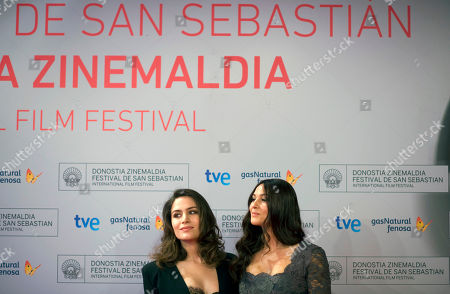 Monica Bellucci, Belcim Bilgin Italian actress Monica Bellucci, right, poses beside Turk actress Belcim Bilgin on the red carpet to promote their film ''Rhino Season'', at the 60th San Sebastian Film Festival, in San Sebastian northern Spain