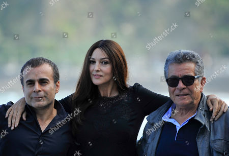 Monica Bellucci, Bahman Ghobadi, Sabri Ozel Italian actress Monica Bellucci, center, poses with Iranian film director Bahman Ghobadi, left, and Turkish producer Sabri Ozel, during the photo call to promote their film ''Rhino Season'', at the 60th San Sebastian Film Festival, in San Sebastian northern Spain