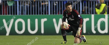 Francesco Acerbi AC Milan's coach Marco Amelia reacts during their Champions League Group C soccer match against Malaga at the Rosaleda stadium in Malaga, Spain