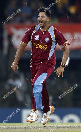 Stock Image of Ravi Rampaul West Indies' bowler Ravi Rampaul celebrates the dismissal of Australia's batsman David Hussey, not seen, during the ICC Twenty20 Cricket World Cup semifinal match in Colombo, Sri Lanka