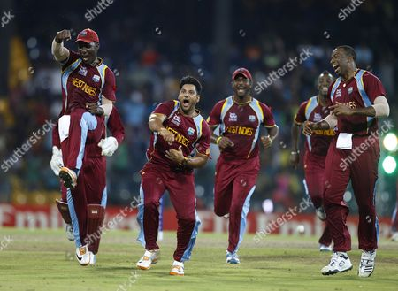 Stock Picture of Ravi Rampaul, Darren Sammy West Indies' bowler Ravi Rampaul, second left without cap, and captain Darren Sammy, left, celebrate with teammates the dismissal of Australia's batsman David Hussey, not seen, during the ICC Twenty20 Cricket World Cup semifinal match in Colombo, Sri Lanka