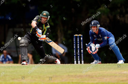 Michael Hussey, Craig Kieswetter Australia's Michael Hussey plays a shot in front of England's wicketkeeper Craig Kieswetter, right, during their warm-up match ahead of the ICC Twenty20 Cricket World Cup in Colombo, Sri Lanka, . The tournament starts Sept. 18