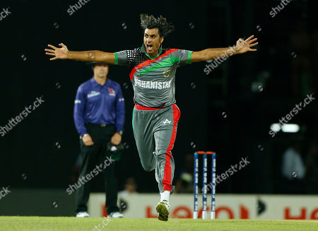 Shapoor Zadran Afghanistan's bowler Shapoor Zadran, celebrates taking the wicket of England's batsman Craig Kieswetter, unseen, during their match in the ICC Twenty20 Cricket World Cup in Colombo, Sri Lanka