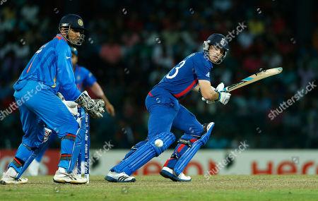 Mahendra Singh Dhoni, Craig Kieswetter England's batsman Craig Kieswetter, right, plays a shot as Indian captain Mahendra Singh Dhoni looks on in an ICC Twenty20 Cricket World Cup match in Colombo, Sri Lanka