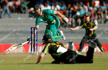 A.B. de Villiers, Xavier Doherty South African captain A.B. de Villiers, center top, successfully completes a run as Australia's fielder Xavier Doherty, bottom, returns the ball to wicket during their ICC Twenty20 Cricket World Cup Super Eight match in Colombo, Sri Lanka