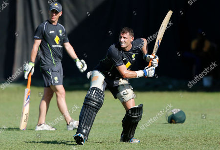 Michael Hussey, Xavier Doherty Australia's cricketer Michael Hussey, right, practices his shots near teammate Xavier Doherty during a training session ahead of the ICC Twenty20 Cricket World Cup semifinal match against West Indies in Colombo, Sri Lanka