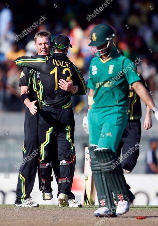Xavier Doherty, Matthew Wade, Jean-Paul Duminy Australia's bowler Xavier Doherty, left celebrates the dismissal of South Africa's batsman Jean-Paul Duminy, right, with wicket keeper Matthew Wade, center, during a ICC Twenty20 Cricket World Cup Super Eight match between South Africa and Australia in Colombo, Sri Lanka