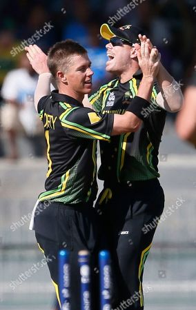 Xavier Doherty, David Warner Australia's bowler Xavier Doherty, left, celebrates the dismissal of South Africa's batsman Richard Levi, unseen, with David Warner during a ICC Twenty20 Cricket World Cup Super Eight match between South Africa and Australia in Colombo, Sri Lanka