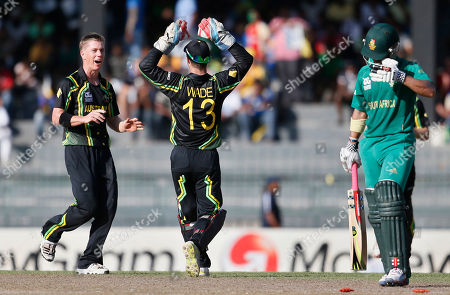 Xavier Doherty, Matthew Wade, Jean-Paul Duminy Australia's bowler Xavier Doherty, left, celebrates the dismissal of South Africa's batsman Jean-Paul Duminy, right, with wicket keeper Matthew Wade, center, during a ICC Twenty20 Cricket World Cup Super Eight match between South Africa and Australia in Colombo, Sri Lanka