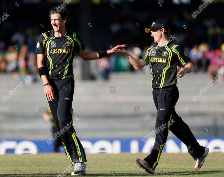 Xavier Doherty, George Bailey Australia's bowler Xavier Doherty, left, celebrates the dismissal of Pakistan's batsman Nasir Jamshed, unseen, with captain George Bailey, right, during their ICC Twenty20 Cricket World Cup Super Eight match bin Colombo, Sri Lanka