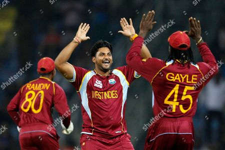 Ravi Rampaul, Chris Gayle West Indies' bowler Ravi Rampaul, center, celebrates with teammate Chris Gayle, right, after taking the wicket of England's batsman Craig Kieswetter, not seen, during the ICC Twenty20 Cricket World Cup Super Eight match in Pallekele, Sri Lanka