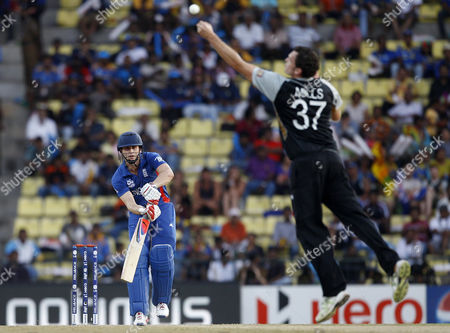 Kyle Mills, Craig Kieswetter New Zealand's bowler Kyle Mills, right, dives to catch the ball after a shot played by England's batsman Craig Kieswetter, left, during their ICC Twenty20 Cricket World Cup Super Eight match in Pallekele, Sri Lanka