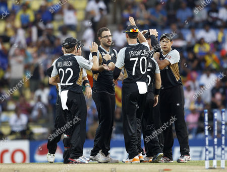 Daniel Vettori New Zealand's bowler Daniel Vettori, center without cap, celebrates with teammates the dismissal of England's batsman Craig Kieswetter, not seen, during their ICC Twenty20 Cricket World Cup Super Eight match in Pallekele, Sri Lanka