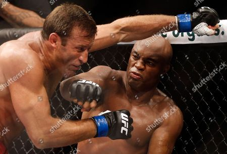 Anderson Silva, Stephan Bonnar Anderson Silva, right, from Brazil, throws a punch at Stephan Bonnar, from the United States, during their light heavyweight mixed martial arts bout at UFC 153 in Rio de Janeiro. Silva tumbled from the pinnacle of mixed martial arts in 2013, finishing the year with a badly broken leg an-d no title belt. The greatest fighter in MMA history insists he never considered retiring, and he returns from a 13-month absence Saturday against Nick Diaz at UFC 183