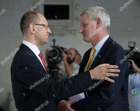Carl Bildt, Arseniy Yatsenyuk Minister for Foreign Affairs of Sweden, Carl Bildt, right, and Ukrainian opposition leader Arseniy Yatsenyuk seen during the 9th Yalta Annual Meeting entitled 'Ukraine and the World: Addressing Tomorrow's Challenges Together', organized by the Yalta European Strategy (YES) in partnership with the Victor Pinchuk Foundation at the Livadia Palace in Yalta, Ukraine, . More than 200 leaders from politics, business and society representing more than 20 countries will discuss major global challenges and their impact on Europe, Ukraine and the world
