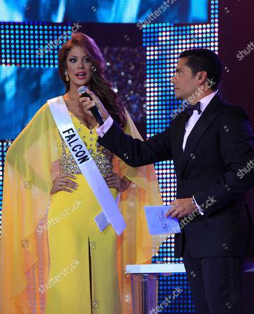 Miss Falcon Alyz Henrich, left, answers a question as CNN journalist Ismael Cala listens during the Miss Venezuela 2012 beauty pageant in Caracas, Venezuela
