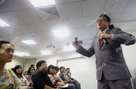 "On, Australian Brian Tan, right, a ""blue diamond"" sales executive of Nu Skin, a multilevel marketing company, speaks during a presentation to economic students to expand and recruit distributors for his sales system at Nu Skin's office in Ho Chi Minh City, Vietnam. Nu Skin, which has stormed through Asia over the last two decades, racked up huge profits despite regulatory scrutiny over its marketing practices and the efficacy of the products that it sells. Multilevel marketing businesses have a strained history in China and Vietnam, whose Communist rulers have been wary of pyramid-based sales schemes that have been characterized by some as preying on the dreams of poor citizens. They also fear that unrest as a result of associated scams from the schemes could challenge their legitimacy"