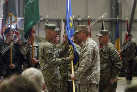 John Allen, James L. Terry U.S. Gen. John R. Allen, right, commander of the NATO forces in Afghanistan, hands over the International Security Assistance Force Joint Command's flag to incoming commander U.S. Army Lt. Gen. James L. Terry during a change of command ceremony in Kabul, Afghanistan, . U.S. Army Lt. Gen. James L. Terry assumed command of the International Security Assistance Force Joint Command (IJC) from U.S. Army Lt. Gen. Curtis M. Scaparrotti. NATO forces will hand over security responsibilities of Afghanistan to Afghan security forces by the end of 2014