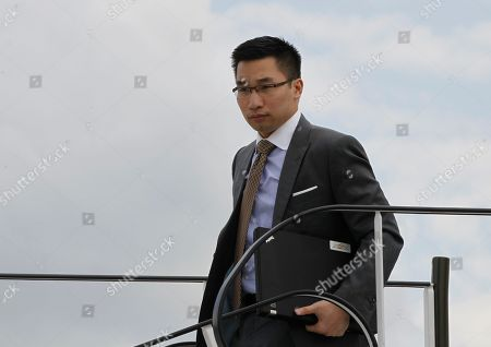 Alex Wong Alex Wong, policy adviser to Republican presidential candidate and former Massachusetts Gov. Mitt Romney, deplanes in Gdansk, Poland