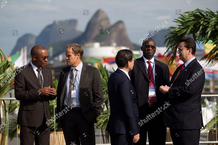 Mayors from left to right: Franklyn Tau of Johannesburg, Ecktar Wuerzner of Heidelberg, Won Soon Park of Seoul, Babatunde Fashola of Lagos and Gilberto Kassab of Sao Paulo, talk as they wait for others mayors to arrive during the Rio+C40, a parallel taking place alongside the United Nations Conference on Sustainable Development, or Rio+20, in Rio de Janeiro, Brazil, . The Earth summit runs through June 22, with three final days of high-profile talks among some 130 top leaders from nations around the globe. While squabbling between rich and poor countries threatens to derail the United Nations' Rio+20 conference, the world's mayors say can't afford the luxury of endless, fruitless negotiations and are already taking real action to stave off environmental disaster and preserve natural resources for future generations