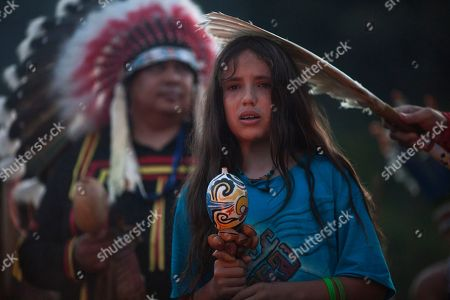 Xiuhtezcatl Martinez from Azteca tribe participates in the Sacred Fire Lighting Ceremony at the Kari-Oca village, where indigenous from around the world wait for the United Nations Conference on Sustainable Development, or Rio+20, in Rio de Janeiro, Brazil, . The Rio+20 conference is expected to draw some 50,000 participants including delegates, environmental activists, business leaders and indigenous groups. The event runs through June 22, with three final days of high-profile talks among some 130 top leaders from nations around the globe