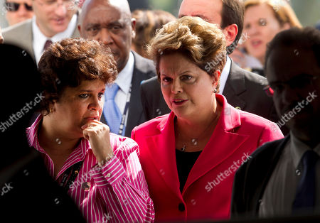 """Brazil's President Dilma Rousseff, right, and Environment Minister Izabella Teixeira arrive for the inauguration of Casa Brasil or Brazil's Pavilion, one of the events taking place on the first day of the United Nations Conference on Sustainable Development, or Rio+20, in Rio de Janeiro, Brazil, . The Rio+20 gathering, that runs from June 13-20, marks the 20th anniversary of the so-called """"Earth Summit"""", which some say put climate change on the world agenda"""