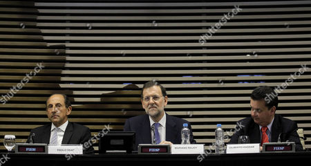 Mariano Rajoy, Paulo Skaf, Gilberto Kassab Spain's Prime Minister Mariano Rajoy, center, Paulo Skaf, president of the Federation of Industries of the State of Sao Paulo, FIESP, and Sao Paulo's Mayor Gilberto Kassab, right, lead a meeting with Spanish and Brazilian businessmen at FIESP, in Sao Paulo, Brazil, . Rajoy is on a two-day official visit to Brazil