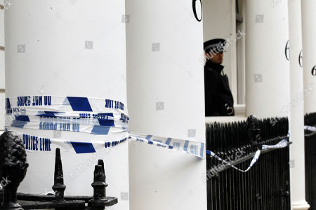 A police officer stands guard outside the home of Britain's richest women, American-born Eva Rausing who was found dead in her home in Belgravia, London
