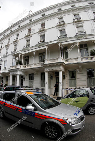 A police officer stands guard outside the home of Britain's richest women, American-born Eva Rausing who was found dead in her home in Belgravia, London, . American-born Eva Rausing, was found dead in her west London home and a man was arrested in connection with the case, British police said, adding that an autopsy had failed to uncover a formal cause of death