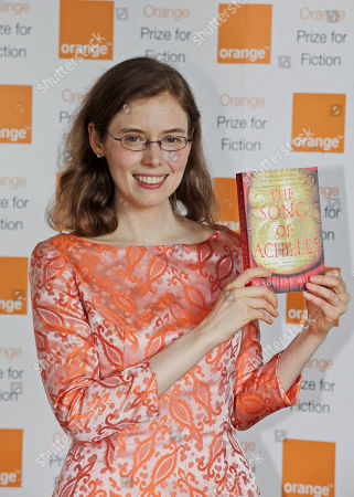 Madeline Miller American author Madeline Miller, holds a copy of her book 'The Song of Achilles' as poses for the photographers, ahead of the announcement of the 2012 Orange for Fiction award in London's Royal Festival Hall, . Miller won the prestigious book award
