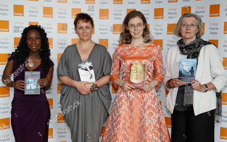 Stock Image of Esi Edugyan, Anne Enright, Madeline Miller, Georgina Harding Authors, from left to right, Esi Edugyan, Anne Enright, Madeline Miller and Georgina Harding, four of the six shortlisted authors for the 2012 Orange Fiction award, pose for the photographers, ahead of the announcement in London's Royal Festival Hall