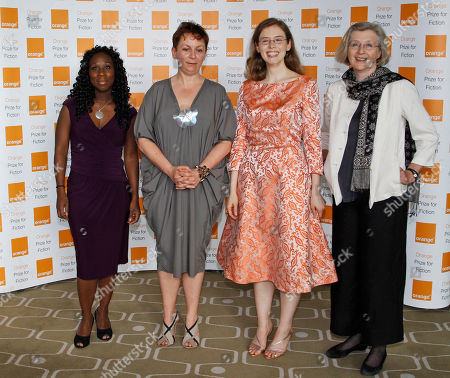 Stock Photo of Esi Edugyan, Anne Enright, Madeline Miller, Georgina Harding Authors, from left to right, Esi Edugyan, Anne Enright, Madeline Miller and Georgina Harding, four of the six shortlisted authors for the 2012 Orange Fiction award, pose for the photographers, ahead of the announcement in London's Royal Festival Hall