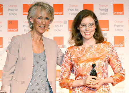 American author Madeline Miller, right, poses for pictures after she received her award from Joanna Trollope, left, the chair of the judges of the 2012 Orange for Fiction award in London's Royal Festival Hall, . Miller won the won the prestigious book award with her book 'The Song of Achilles