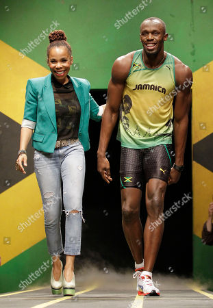 Usain Bolt, Cedella Marley Jamaica's sprinter Usain Bolt models a Jamaica Olympic kit with designer Cedella Marley, daughter of Bob Marley, during the kit unveiling in London