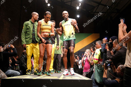 Usain Bolt Jamaica's sprinter Usain Bolt, center, with models show off Jamaica Olympic kit designed by Cedella Marley, daughter of Bob Marley, during the kit unveiling in London