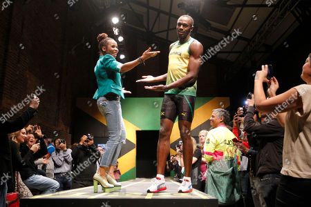 Usain Bolt, Cedella Marley Jamaica's sprinter Usain Bolt, center right, models a Jamaica Olympic kit with designer Cedella Marley, center left, daughter of Bob Marley, during the kit unveiling in London