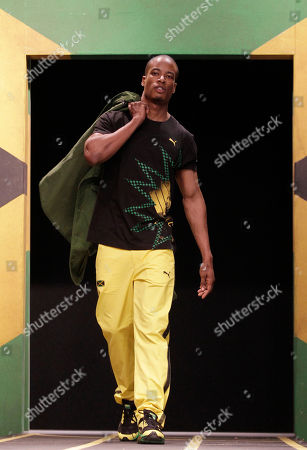 A model displays a Jamaica Olympic kit designed by Cedella Marley, daughter of Bob Marley, during the kit unveiling in London