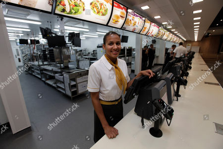 Jill McDonald Rachel Lucian, assistant manager of the newly constructed McDonald's restaurant at the Olympic Park in east London, poses for the photographers, . The restaurant is designed to be reusable and recyclable after the London 2012 Olympic and Paralympic Games
