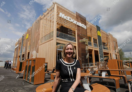 Stock Image of Jill McDonald Jill McDonald, CEO of McDonald's UK, backdropped by the newly constructed McDonald's restaurant at the Olympic Park, poses for the photographers in east London, . The restaurant is designed to be reusable and recyclable after the London 2012 Olympic and Paralympic Games