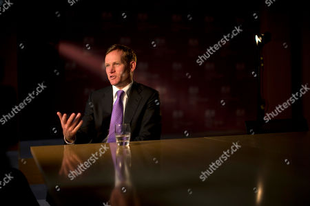 Britain's Minister of State Jeremy Browne, whose responsibilities include the Olympics for the Foreign Office, speaks during an interview with The Associated Press at the Foreign Office in London