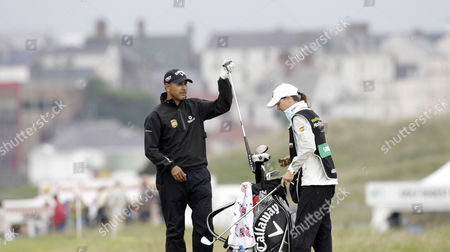 India's Jeev Milkha Singh lifts his putter on the 18th hole on day one of the Irish Open Golf Championship at Royal Portrush Golf Club, Portrush, Northern Ireland