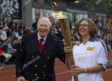 Editorial picture of Britain OLY London 2012 Torch Bannister