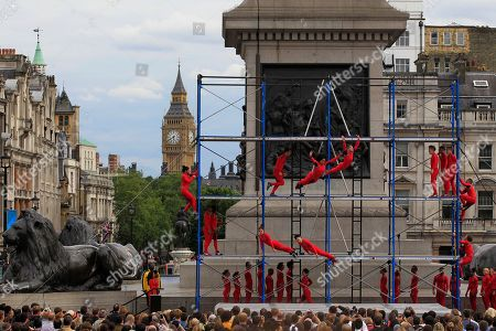 """Backdropped by Big Ben, extreme dancers jump from a platform as they perform at Trafalgar Square in London as part of London 2012 Olympic Festival, . The performances """"Surprises : Streb"""" choreographed by New Yorker Elizabeth Streb take place on various London's landmarks"""