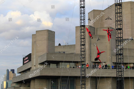 """Extreme dancers perform 'speed angels' outside the National Theatre in London as part of London 2012 Olympic Festival, . The performances """"Surprises :Streb"""" choreographed by New Yorker Elizabeth Streb take place on various London's landmarks"""