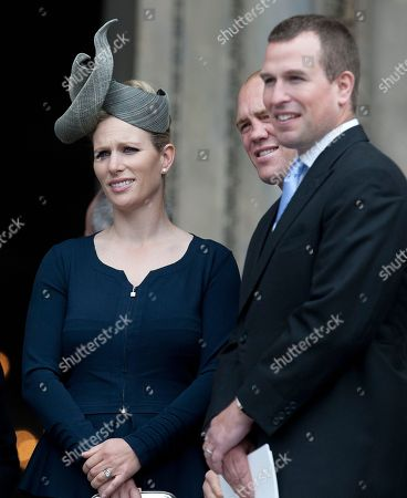 "Britain's Queen Elizabeth's granddaughter Zara Philips left, with her husband Mike Tindall and her brother Peter Philips, right, looks out from the steps of St Paul's Cathedral following a service of thanksgiving for Britain's Queen Elizabeth II Diamond Jubilee celebrations in London, . Crowds cheering ""God save the queen!"" and pealing church bells greeted Queen Elizabeth II on Tuesday as she arrived for a service at St. Paul's Cathedral on the last of four days of celebrations of her 60 years on the throne"