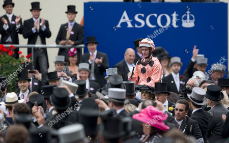 Luke Nolen rides Black Caviar into the winners enclosure after the Australian horse won the Diamond Jubilee Stakes on the fifth day of Royal Ascot horse race meeting at Ascot, England