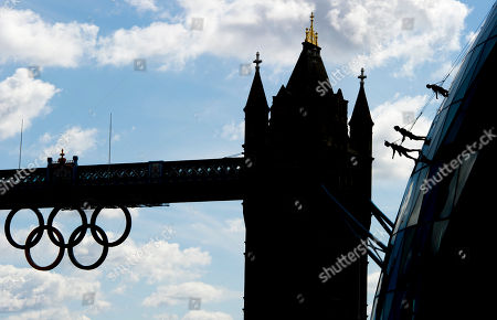 Stock Picture of Streb Artists from performance company STREB, founded by Elizabeth Streb, perform an acrobatic abseil down City Hall, London