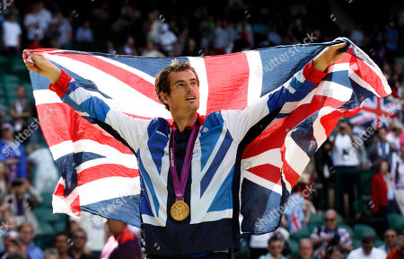 Stock Image of Andy Murray Gold medalist Andy Murray of Great Britain waves the British flag during the medal ceremony of the men's singles event at the All England Lawn Tennis Club at Wimbledon, in London, at the 2012 Summer Olympics. Defending Olympic champion Andy Murray will lead a four-member British tennis team at the Rio de Janeiro Games