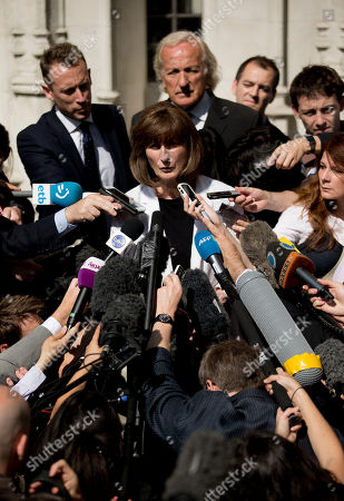 Stock Photo of Gareth Peirce, center, the solicitor of WikiLeaks founder Julian Assange, who did not appear at court, faces the microphones speaking to the media after the verdict was given in his extradition case at the Supreme Court in London, . Britain's Supreme Court has endorsed the extradition of WikiLeaks chief Julian Assange to Sweden, bringing the secret-spilling Internet activist a big step closer to prosecution in a Scandinavian court. Assange, 40, has spent the better part of two years fighting attempts to send him to the Sweden, where he is wanted for questioning in sex crime allegations. He has not been charged there