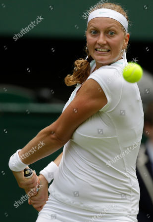 Petra Kvitova of the Czech Republic returns a shot Akgul Amanmuradova of Uzbekistan during a first round women's singles match at the All England Lawn Tennis Championships at Wimbledon, England